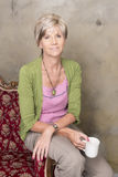 Middle aged woman with cup of coffee Royalty Free Stock Photography