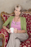 Middle aged woman with cup of coffee Royalty Free Stock Photo