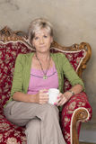 Middle aged woman with cup of coffee Stock Image