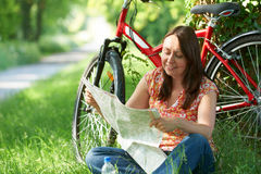 Middle Aged Woman On Cycle Ride In Countryside Reading Map Royalty Free Stock Images