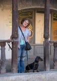 Middle-aged woman with dachshund in old shopping arcade, Yuryev-Polsky, Vladimir Region, Russia. Middle-aged woman with dachshund in old shopping arcade, Yuryev stock photos
