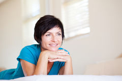 Middle aged woman daydreaming Royalty Free Stock Photos