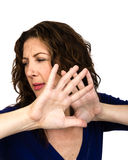 Middle aged woman defending herself Royalty Free Stock Images