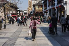 A middle-aged woman delivering takeout. A middle-aged woman delivering takeout at a restaurant in nanjing, jiangsu province, is working royalty free stock photography