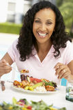 Middle Aged Woman Dining Al Fresco Royalty Free Stock Photography