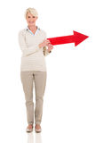 Middle aged woman direction arrow Royalty Free Stock Photography