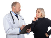 Middle aged woman at the doctor Royalty Free Stock Photos