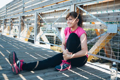 Middle aged woman doing stretching exercises stock photos