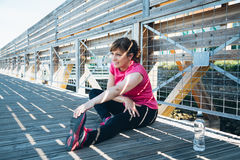 Middle aged woman doing stretching exercises Stock Images