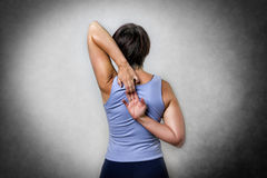 Middle aged woman doing stretching Royalty Free Stock Photo