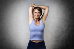 Middle aged woman doing stretching Royalty Free Stock Photography