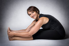 Middle aged woman doing stretching Royalty Free Stock Photos
