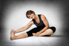 Middle aged woman doing stretching Stock Photo