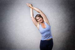 Middle aged woman doing stretching Stock Image