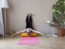 Middle aged woman doing yoga indoors Stock Photo