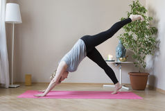Middle aged woman doing yoga indoors Royalty Free Stock Images