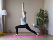 Middle aged woman doing yoga indoors Stock Images