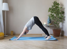 Middle aged woman doing yoga indoors Stock Image