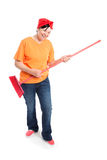 Middle aged woman with dotted broom Royalty Free Stock Photos