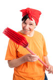 Middle aged woman with dotted broom Royalty Free Stock Photo