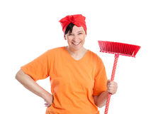 Middle aged woman with dotted broom Royalty Free Stock Image