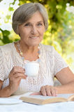 Middle-aged woman drink tea Stock Image
