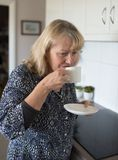 Middle-aged Woman Drinking Coffee. Stock Photos