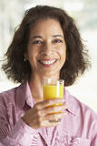 Middle Aged Woman Drinking Fresh Orange Juice Stock Image