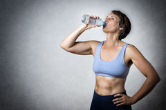 Middle aged woman drinking Royalty Free Stock Photo