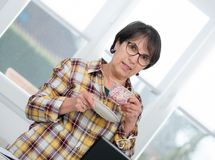 Middle-aged woman drinks cup of coffee. Middle-aged woman drinking a cup of coffee Royalty Free Stock Image