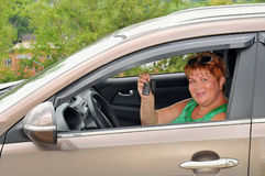 Middle aged woman driving car Stock Photo