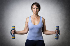 Middle aged woman with dumbbells Stock Photo