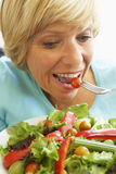 Middle Aged Woman Eating Healthy Salad.  Stock Photo