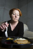 Middle Aged Woman Eating TV Dinner Stock Images