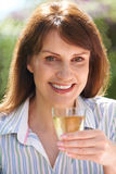 Middle Aged Woman Enjoying Glass Of White Wine Stock Images