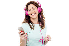Middle aged woman enjoying listening music Royalty Free Stock Photography