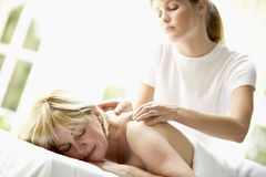 Middle Aged Woman Enjoying Massage Stock Photography