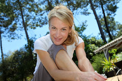 Middle-aged woman excercising on terrace Stock Image