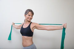 Middle aged woman with an exercise band. Royalty Free Stock Images