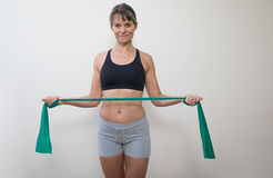 Middle aged woman with an exercise band. Stock Photo
