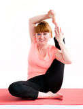 Middle aged woman exercise yoga Royalty Free Stock Images