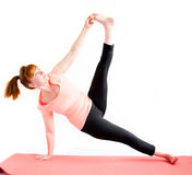 Middle aged woman exercise yoga Stock Images