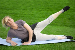 Middle aged woman exercising Stock Photos