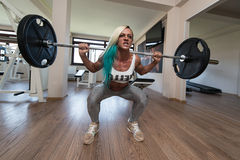 Middle Aged Woman Exercising Barbell Squat Royalty Free Stock Photos