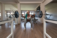 Middle Aged Woman Exercising Barbell Squat Stock Photo