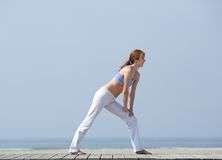 Middle aged woman exercising at the beach Royalty Free Stock Photo