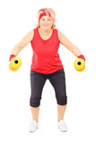 Middle aged woman exercising with dumbbells Stock Image