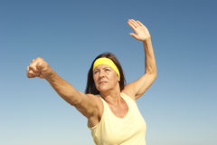 Middle aged woman exercising outdoor  Royalty Free Stock Images