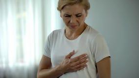 Middle aged woman feeling pain in breast, mammology problems, mastodynia