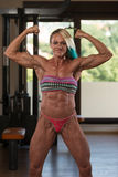 Middle Aged Woman Flexing Muscles In The Gym Royalty Free Stock Image